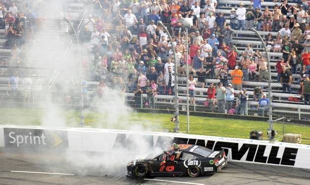Kurt Busch exits his car after hitting the wall in the first turn during the STP 500 NASCAR Sprint Cup series auto race at Martinsville Speedway in Martinsville, Va., Sunday, April 7, 2013. (AP Photo/Don Petersen)