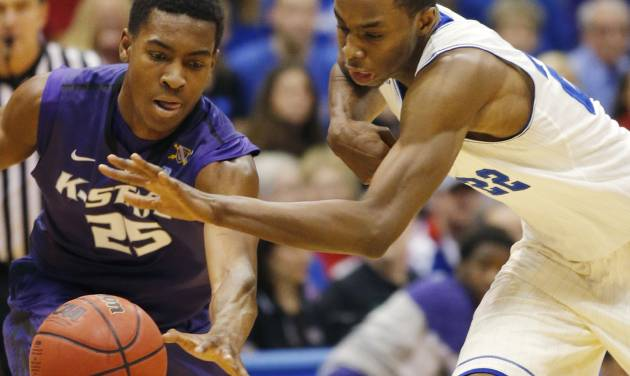 Kansas guard Andrew Wiggins, right, gets to the ball ahead of Kansas State's Wesley Iwundu (25) during the first half of an NCAA college basketball game in Lawrence, Kan., Saturday, Jan. 11, 2014. (AP Photo/Orlin Wagner)
