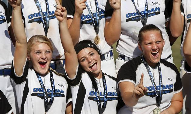 Wearing championship medals they just received, Oologah players celebrate while posing for their commemorative team photo after the game. From left are seniors Ally Nall and Randye Sharp and junior Jennifer Hertel. Class 4A high school championship softball game between Oologah and Piedmont at Hall of Fame Stadium in Oklahoma City on Saturday, Oct. 15, 2012.  Oologah won the game in the bottom of the sixth inning when Baleigh Hamilton scored the winning run on a hit by Alex Edinger, allowing them to claim the victory by virtue of the the run rule, defeating Piedmont,  10-0.    Photo by Jim Beckel, The Oklahoman