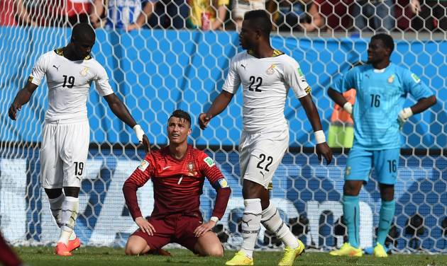 Portugal's Cristiano Ronaldo, center, reacts after missing a chance during the group G World Cup soccer match between Portugal and Ghana at the Estadio Nacional in Brasilia, Brazil, Thursday, June 26, 2014.  Portugal won 2-1 but were eliminated from the competition.  (AP Photo/Paulo Duarte)