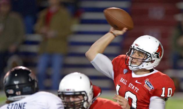 Ball State quarterback Keith Wenning (10) throws as pass as offensive lineman Steven Bell (66) blocks Arkansas State defensive end Chris Stone (42) in the first quarter of the GoDaddy Bowl NCAA college football game, Sunday, Jan. 5, 2014, in Mobile, Ala. (AP Photo/G.M. Andrews)