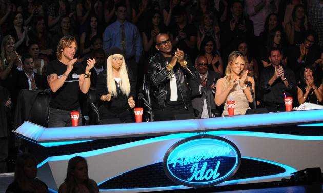 """This undated image released by Fox shows judges, from left, Keith Urban, Nicki Minaj, Randy Jackson and Mariah Carey from the singing competition series, """"American Idol,"""" airing Wednesdays and Thursdays on Fox. In its 12th season, """"American Idol"""" is managing to hit the right notes with sponsors if not always with fickle viewers. It has retained its status as TV's advertising leader among series and the loyalty of its biggest backers, including Ford and Coca-Cola. (AP Photo/Fox, Frank Micelotta)"""