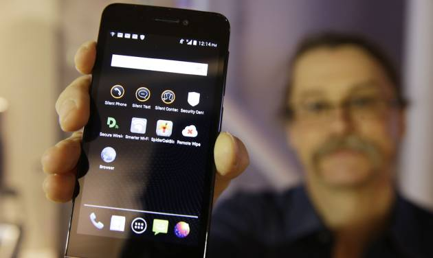 "In this photo taken Wednesday, July 30, 2014, Silicon Valley pioneer and Silent Circle co-founder Jon Callas holds up Blackphone with encryption apps displayed on it at the Computer History Museum in Mountain View, Calif. Revelations about the NSA's electronic eavesdropping capabilities, with targets reported to include Chancellor Angela Merkel, have sparked anger in Germany, and a boom in encryption services that make it hard for the most sophisticated spies to read emails, listen to calls or comb through texts. ""Snowden's leaks were a real boon for us,"" said Callas, whose company sells an encryption app which allows users to talk and text in private. (AP Photo/Eric Risberg)"