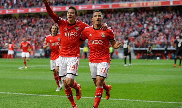 Benfica's Lima, right, celebrates with teammate Rodrigo after scoring the opening goal during their Portuguese league soccer match with Academica Sunday, March 23 2014, at Benfica's Luz stadium in Lisbon. (AP Photo/Armando Franca)