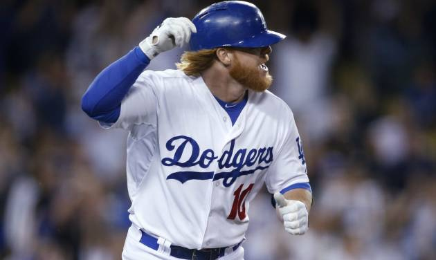 Los Angeles Dodgers' Justin Turner runs up the first base line after hitting an RBI single to score Juan Uribe against the St. Louis Cardinals during the eighth inning of a baseball game, Thursday, June 26, 2014, in Los Angeles. (AP Photo/Danny Moloshok)