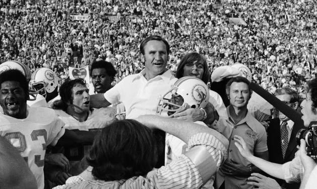 FILE - In this Jan. 14, 1973 file photo,  Miami Dolphins coach Don Shula is carried off the field after his team won NFL football Super Bowl game with a 14-7 victory over Washington Redskins in Los Angeles. Shula is having the 1972 Dolphins over to his house for dinner Thursday night to help celebrate the 40th anniversary of their perfect season. (AP Photo/File)