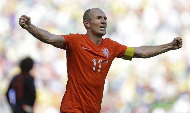 Netherlands' Arjen Robben celebrates after the World Cup round of 16 soccer match between the Netherlands and Mexico at the Arena Castelao in Fortaleza, Brazil, Sunday, June 29, 2014. The Netherlands won the match 2-1. (AP Photo/Natacha Pisarenko)
