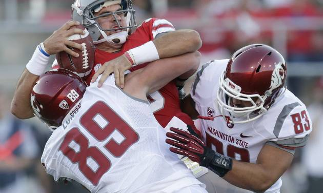 UNLV quarterback Nick Sherry is sacked by Washington State linebackers Travis Long (89) and Logan Mayes (83) during the first quarter of an NCAA college football game, Friday, Sept. 14, 2012, in Las Vegas. (AP Photo/Julie Jacobson)