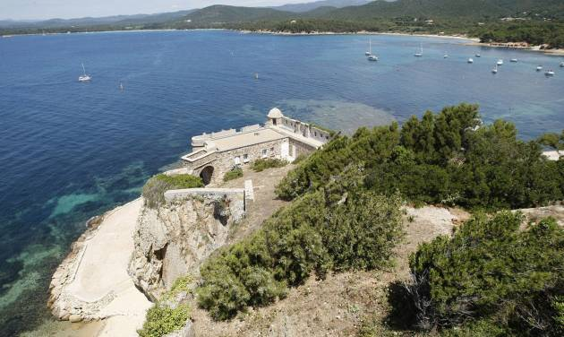 This July 1, 2014 photo shows a view of the Mediterranean Sea from the Fort de Bregancon, which has been the holiday retreat of French presidents for decades, in Bormes-les-Mimosas, southern France. Socialist President Francois Hollande has decided to break with tradition and open it to the public for the first time _ as a symbol of the reduction of the presidential lifestyle in tough economic times. The stylish villa is located on one of the most beautiful and unspoilt parts of the French Riviera. (AP Photo/Claude Paris)
