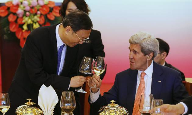 China's State Councillor Yang Jiechi, left, shares a toast with U.S. Secretary of State John Kerry before a working lunch at the U.S.-China Strategic and Economic Dialogue, at the Diaoyutai State Guesthouse in Beijing Wednesday, July 9, 2014. (AP Photo/Jim Bourg, Pool)