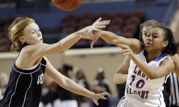 Verdigris' Stacia Payne (3) defends on Millwood's Teanna Reid (10) during the 3A girls quarterfinals game between Millwood High School and Verdigris High School at the State Fair Arena on Thursday, March 7, 2013, in Oklahoma City, Okla. Photo by Chris Landsberger, The Oklahoman