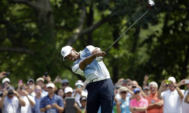Tiger Woods hits his tee shot on the second hole during a practice round for the PGA Championship golf tournament at Valhalla Golf Club on Wednesday, Aug. 6, 2014, in Louisville, Ky. The tournament is set to begin on Thursday. (AP Photo/David J. Phillip)