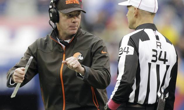Cleveland Browns head coach Pat Shurmur, left, argues a call with referee Clete Blakeman (34) during the first half of an NFL football game on Sunday, Oct. 7, 2012, in East Rutherford, N.J. (AP Photo/Kathy Willens)