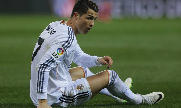 Real's Cristiano Ronaldo on the turf during a semi final, 2nd leg, Copa del Rey soccer match between Atletico de Madrid and Real Madrid at the Vicente Calderon stadium in Madrid, Spain, Tuesday, Feb. 11, 2014. (AP Photo/Andres Kudacki)
