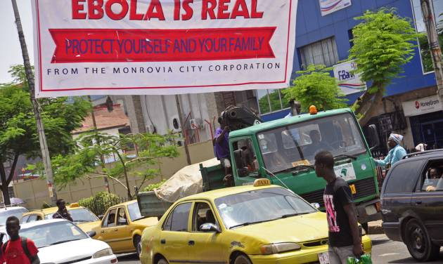 A banner reading 'Ebola is real, Protect yourself and your family', warns people of the Ebola virus in Monrovia, Liberia, Saturday Aug. 2, 2014. An Ebola outbreak that has killed more than 700 people in West Africa is moving faster than efforts to control the disease, the head of the World Health Organization warned, as presidents from the affected countries met Friday in Guinea's capital. (AP Photo/Abbas Dulleh)