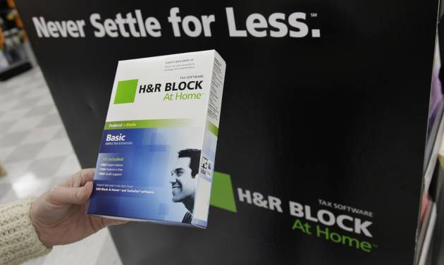 This Jan. 24, 2012 photo, shows Andrea Lucas poses with H&R Block tax software at OfficeMax in Mountain View, Calif. H&R Block's fiscal second-quarter loss narrowed, helped by cost-cutting efforts, the company said Thursday, Dec. 6, 2012. Revenue climbed mostly because of a strong tax season in Australia. The nation's largest tax preparation company typically turns in a loss in the August-to-October period because it takes in most of its revenue during the U.S. tax season. (AP Photo/Paul Sakuma)