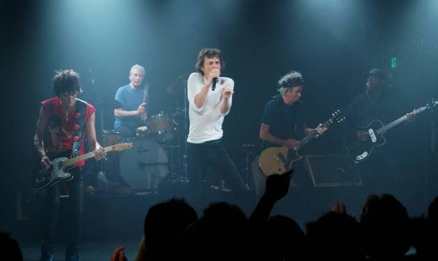 """This Saturday, April 27, 2013 photo provided by The Rolling Stones shows the group performing during a surprise gig at the Echoplex in Los Angeles. The legendary group rocked a small club in Los Angeles on Saturday night for a minuscule crowd compared to the thousands set to see them launch their """"50 and Counting"""" anniversary tour a week later on May 3 at the Staples Center. (AP Photo/The Rolling Stones, Luis Soto)"""