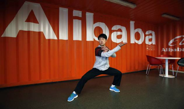 FILE - In this file photo taken Tuesday March 26, 2013, a worker performs shadow boxing during an open day at the Alibaba Group office in Hangzhou in east China's Zhejiang province. Alibaba Group is aiming to raise $1 billion in a long-awaited IPO likely to have ripple effects across the Internet. The Tuesday, May 6, 2014 filing sets the stage for the technology industry's biggest initial public offering since short messaging service Twitter and its early investors collected $1.8 billion in its stock market debut last fall.  (AP Photo) CHINA OUT
