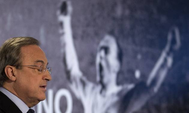 Real Madrid's President Florentino Perez makes a speech in front of a poster of Alfredo Di Stefano in the Santiago Bernabeu stadium before making a speech in Madrid, Spain, Monday, July 7, 2014 after football great Alfredo Di Stefano died. He was 88. The former Argentina forward was hospitalized on Saturday after a heart attack. He had been in a coma since at Gregorio Maranon hospital in the Spanish capital where he passed away. Di Stefano helped Madrid win five straight European Champions Cups from 1956-60 and eight Spanish league titles. He was voted European player of the year in 1957 and 1959. (AP Photo/Paul White)