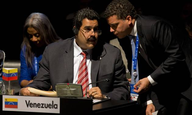 "Venezuela's Vice President Nicolas Maduro, left, speaks and a member of his delegation speak during the closing ceremony of the CELAC-EU summit in Santiago, Chile, Sunday, Jan. 27, 2013. A 60-nation summit wrapped up in Chile on Sunday with leaders from the European Union, Latin America and the Caribbean renewing calls for giving investors ""legal certainty"" and dropping barriers to trade between economies that together represent a billion people and $280 billion in commerce. (AP Photo/Victor R. Caivano)"