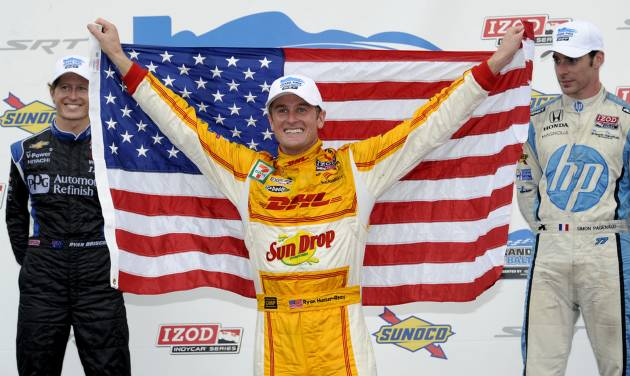 Ryan Hunter-Reay celebrates in victory lane after winning the IZOD IndyCar Grand Prix of Baltimore auto race, Sunday, Sept. 2, 2012, in Baltimore. At left is runner up Ryan Briscoe, of Australia, and at right is Simon Pagenaud, of France, third place finisher. (AP Photo/Nick Wass) ORG XMIT: MDNW101