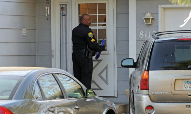 Police investigate the scene where three people were shot and killed at an in-home day care in Brooklyn Park, Minn., on Monday, April 9, 2012. No arrests were immediately made. (AP Photo/The Star Tribune, Richard Sennott) MANDATORY CREDIT; ST. PAUL PIONEER PRESS OUT; MAGS OUT; TWIN CITIES TV OUT