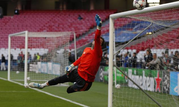 Real goalkeeper Iker Casillas reaches to stop the ball, during a training session ahead of Saturday's Champions League final soccer match between Real Madrid and Atletico Madrid, in Luz stadium in Lisbon, Portugal, Friday, May 23, 2014. (AP Photo/Daniel Ochoa de Olza)