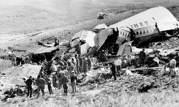 FILE - This May 23, 1962 file photo shows officials searching the wreckage of Continental Airlines Flight 11 which crashed near Unionville, Mo. Aviation buffs know Flight 11 as the country's first bombing of a commercial jet airliner, an act of sabotage by a passenger that killed all 45 people on board. Yet the crash of the plane, which departed Chicago en route to Los Angeles with a Kansas City stop, was largely forgotten as time passed, families moved on and more horrific airline incidents came to dominate history. (AP Photo/Kansas City Star, File)