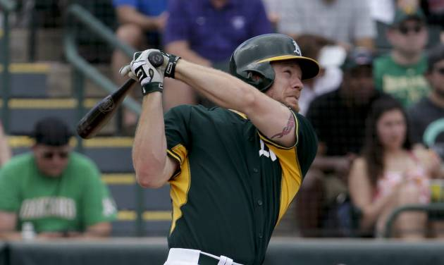 Oakland Athletics' Brandon Moss watches his three-run home run against the Cincinnati Reds during the second inning of a spring exhibition baseball game in Phoenix, Tuesday, March 25, 2014. (AP Photo/Chris Carlson)