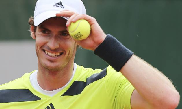 Britain's Andy Murray adjusts his cap as he plays Kazakhstan's Andrey Golubev during the first round match of  the French Open tennis tournament at the Roland Garros stadium, in Paris, France, Tuesday, May 27, 2014. Murray won 6-1, 6-4, 3-6, 6-3. (AP Photo/David Vincent)