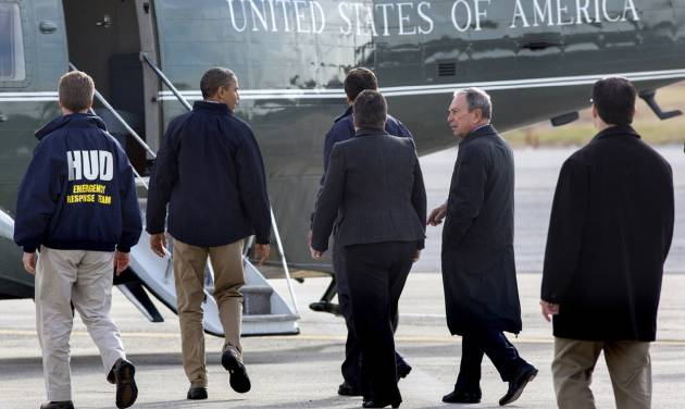 President Barack Obama, second from left, accompanied by, from left, Housing and Urban Development Secretary Shaun Donovan, New York Gov. Andrew Cuomo, Homeland Security Secretary Janet Napolitano, and New York City Mayor Michael Bloomberg, walks towards the Marine One helicopter at JFK International Airport in New York, Thursday, Nov. 15, 2012, before taking a aerial tour of damage along the New York coastline to view damage from Superstorm Sandy. (AP Photo/Craig Ruttle)