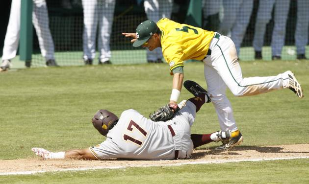 Sacramento State third baseman Will Soto, top, tags out Arizona State's Drew Stankiewicz during a rundown on the third base line in the ninth inning of a NCAA college baseball tournament regional game on Saturday, May 31, 2014, in San Luis Obispo, Calif. (AP Photo/Aaron Lambert)