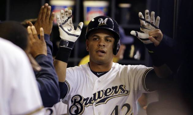 Milwaukee Brewers' Aramis Ramirez is congratulated in the dugout after hitting a home run during the fifth inning of the MLB National League baseball game against the St. Louis Cardinals Tuesday, April 15, 2014, in Milwaukee. (AP Photo/Morry Gash)