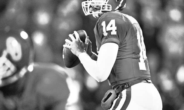 Sam Bradford may have an NFL-ready resume, but the Sooner quarterback has yet to say whether he'll return for another season at OU or turn pro.  PHOTO BY STEVE SISNEY, THE OKLAHOMAN