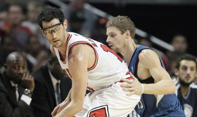 Chicago Bulls guard Kirk Hinrich (12), left, controls the ball as Minnesota Timberwolves guard Luke Ridnour (13) guards during the first half of an NBA basketball game in Chicago on Saturday, Nov. 10, 2012. (AP Photo/Nam Y. Huh)