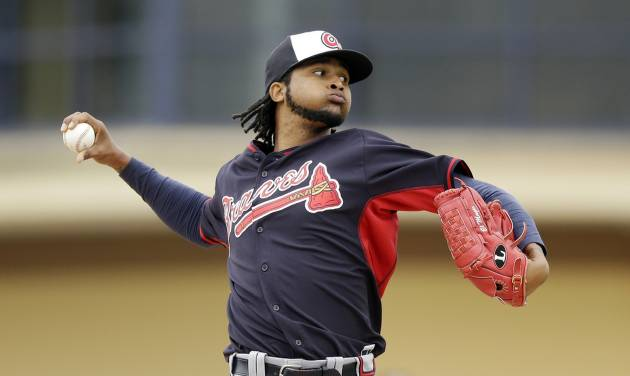 Atlanta Braves starting pitcher Ervin Santana throws during the third inning of a spring exhibition baseball game against the Detroit Tigers in Lakeland, Fla., Tuesday, March 25, 2014. (AP Photo/Carlos Osorio)