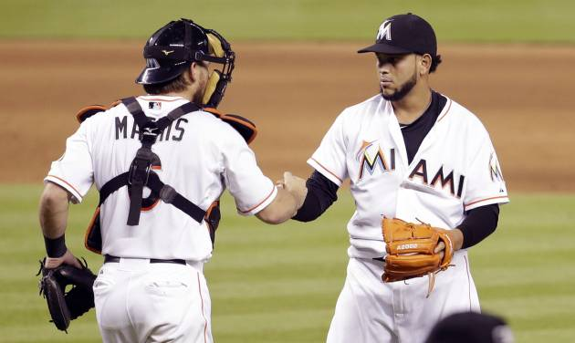 Miami Marlins starting pitcher Henderson Alvarez, right, shakes hands with catcher Jeff Mathis (6) after Alvarez pitched a complete game and the Marlins defeated the Tampa Bay Rays 1-0 in an interleague baseball game, Tuesday, June 3, 2014, in Miami. (AP Photo/Lynne Sladky)