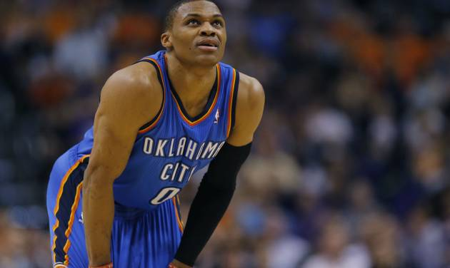 Oklahoma City Thunder guard Russell Westbrook (0) looks at the scoreboard during the first half of an NBA basketball game against the Phoenix Suns on Sunday, April 6, 2014,in Phoenix. (AP Photo/Matt York)