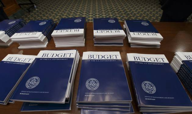 Copies of President Barack Obama's proposed fiscal 2015 budget are set out for distribution by the Senate Budget Committee on Capitol Hill in Washington, Tuesday, March 4, 2014. President Barack Obama is unwrapping a nearly $4 trillion budget that gives Democrats an election-year playbook for fortifying the economy and bolstering Americans' incomes. It also underscores how pressure has faded to launch bold, new attacks on federal deficits.  (AP Photo/J. Scott Applewhite)
