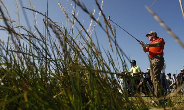 Miguel Angel Jimenez of Spain plays a shot off the 15th tee during the second round of the British Open Golf Championship at Muirfield, Scotland, Friday July 19, 2013. (AP Photo/Jon Super)