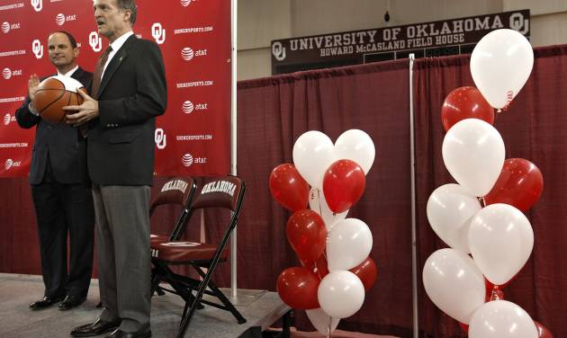 OU / INTRODUCE / INTRODUCTION: University of Oklahoma athletic director Joe Castiglione, left, looks on as new men's college basketball coach Lon Kruger is introduced as the new University of Oklahoma men's basketball coach on Monday, April 4, 2011, in Norman, Okla. Photo by Chris Landsberger, The Oklahoman ORG XMIT: KOD