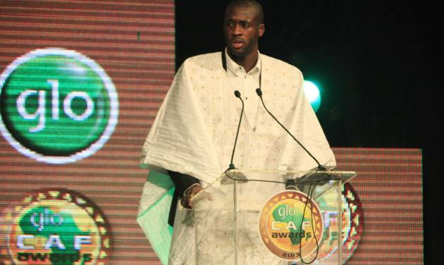 """Yaya Toure, Ivory Coast and Manchester City midfielder, speaks moments he was declared  African soccer player of the year, for a third straight time, at a ceremony in Lagos, Nigeria, Thursday, Jan. 9, 2014.  He beat out fellow Ivorian Didier Drogba, the Galatasaray striker and two-time recipient, and Chelsea midfielder John Obi Mikel of Nigeria. """"To be the winner today is unbelievable,"""" the 30-year-old Toure said. """"I am very happy and very, very proud."""". (AP Photo/Sunday Alamba)"""