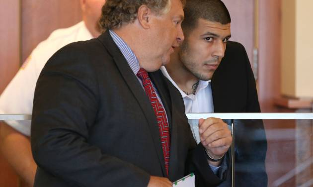 Former New England Patriots player Aaron Hernandez, right, listens to his lawyer, Michael Fee, left, during his arraignment in superior court Friday, Sept. 6, 2013, in Fall River, Mass. Hernandez faces a murder charge in the death of Odin Lloyd, 27, whose body was found by a jogger on June 17 in an industrial park in North Attleborough, Mass., about a mile from Hernandez's home. (AP Photo/The Boston Globe, Jonathan Wiggs, Pool)