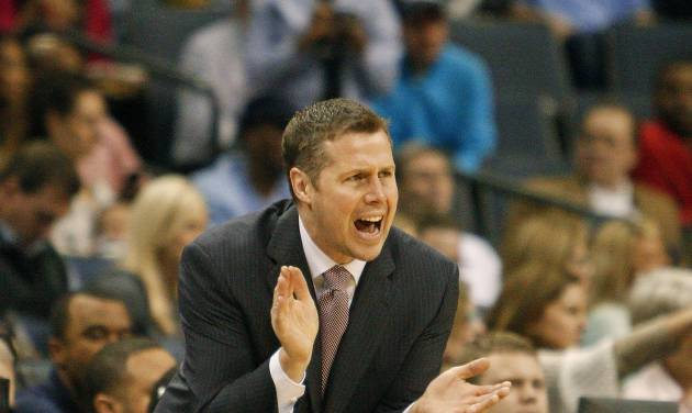 Memphis Grizzlies head coach Dave Joerger calls a play against the Milwaukee Bucks in the first half of an NBA basketball game on Saturday, Feb. 1, 2014, in Memphis, Tenn. (AP Photo/Lance Murphey)