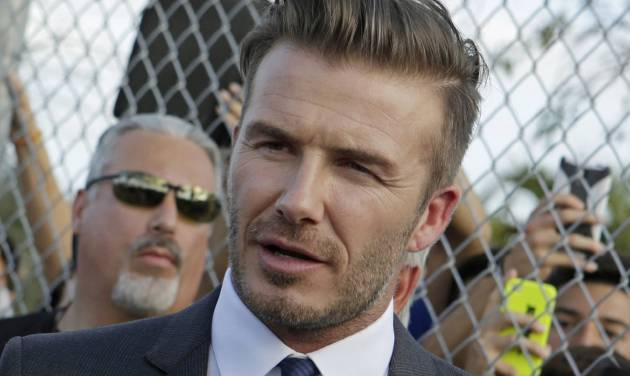 FILE - In this Wednesday, Feb. 5, 2014 file photo, retired soccer player David Beckham talks to fans during a visit at Kendall Soccer Park as he greets South Florida soccer fans and players in Miami. A year after retiring from football, David Beckham's career has entered a new phase, the campaign trail. After making his name bending free kicks and delivering trademark crosses, the former England captain needs the Miami electorate to put a cross next to his plans for a downtown stadium for his new Major League Soccer franchise. (AP Photo/Alan Diaz)