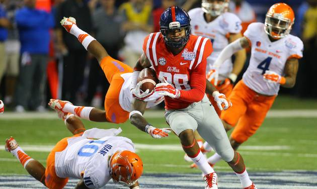 Mississippi wide receiver Cody Core cuts through Boise State defenders for a 76-yard touchdown during the fourth quarter of an NCAA college football game, Thursday, Aug. 28, 2014 in Atlanta. (AP Photo/Atlanta Journal-Constitution, Curtis Compton)  MARIETTA DAILY OUT; GWINNETT DAILY POST OUT; LOCAL TELEVISION OUT; WXIA-TV OUT; WGCL-TV OUT