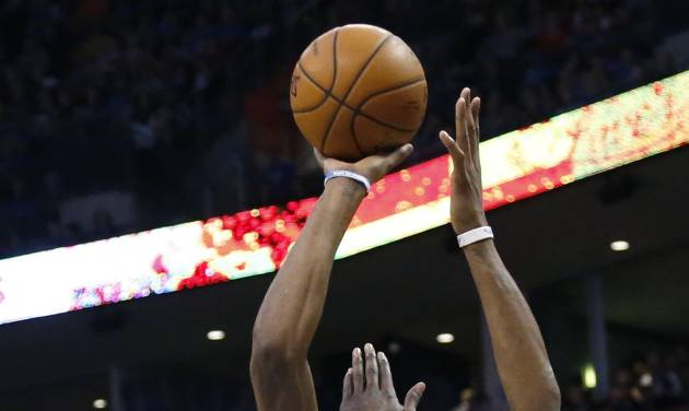 Oklahoma City Thunder forward Kevin Durant (35) shoots over Utah Jazz forward Marvin Williams (2) in the first quarter of an NBA basketball game in Oklahoma City, Sunday, March 30, 2014. Oklahoma City won 116-96. (AP Photo/Sue Ogrocki)
