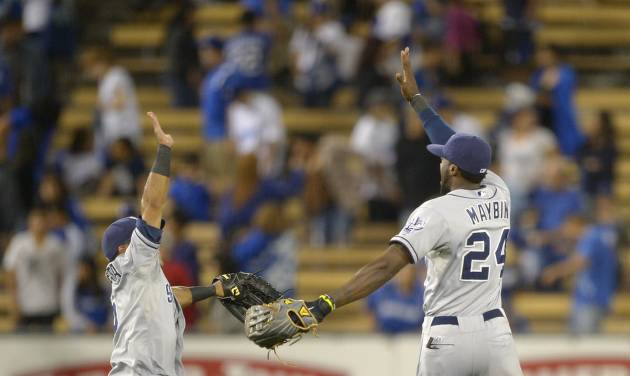San Diego Padres second baseman Alexi Amarista, left, celebrates with center fielder Cameron Maybin after they defeated the Los Angeles Dodgers 4-3 in their baseball game, Wednesday, Sept. 5, 2012, in Los Angeles. (AP Photo/Mark J. Terrill)