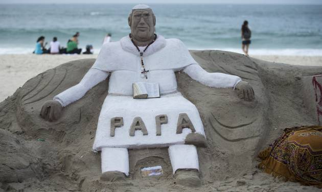 A sand sculpture that resembles Pope Francis sits on Copacabana beach, Rio de Janeiro, Brazil on Sunday, July 21, 2013.  Pope Francis, the 76-year-old Argentine who became the church's first pontiff from the Americas in March, will return Monday to the embrace of Latin America to preside over the Roman Catholic Church's World Youth Day festival.(AP Photo/Victor R. Caivano)