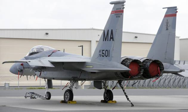 FILE - A Massachusetts Air National Guard F-15C fighter aircraft sits near a hangar at Barnes Air National Guard Base, in Westfield, Mass., Wednesday, Aug. 27, 2014 file photo. The pilot of an F-15 jet that crashed earlier this week in remote Virginia mountains was killed, military officials now say, bringing a sad end to an exhaustive two-day search involving more than 100 local, state and federal officials as well as volunteers. (AP Photo/Steven Senne, File)